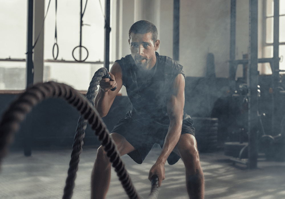 man using ropes for his high intensity interval training exercise