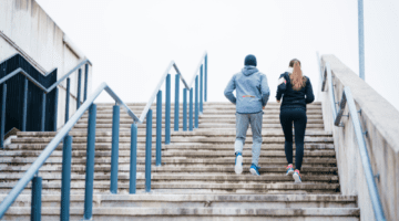 Couple doing interval training on stadium stairs