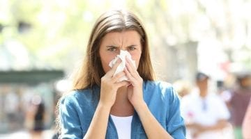 Woman Blowing Mucus Out Of Her Nose, Lungs & Body