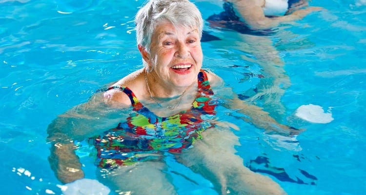 Woman getting light water aerobic exercise