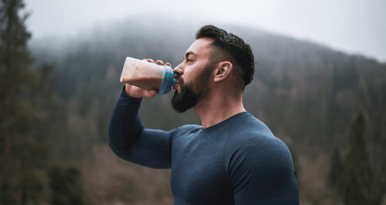 Man drinking meal replacement before a hike with David Aston