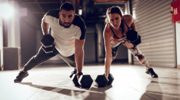 Man and woman strength training together in David Aston's Montana gym.