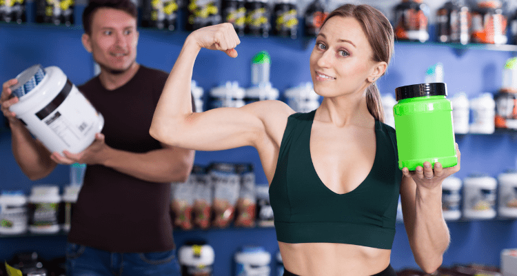 Man and Woman Posing With Their Muscle Building Supplements