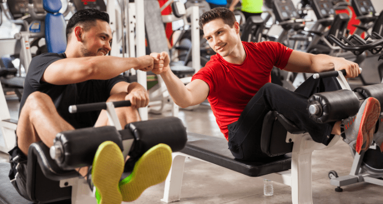 Gym bros working out together and doing the same amount of reps