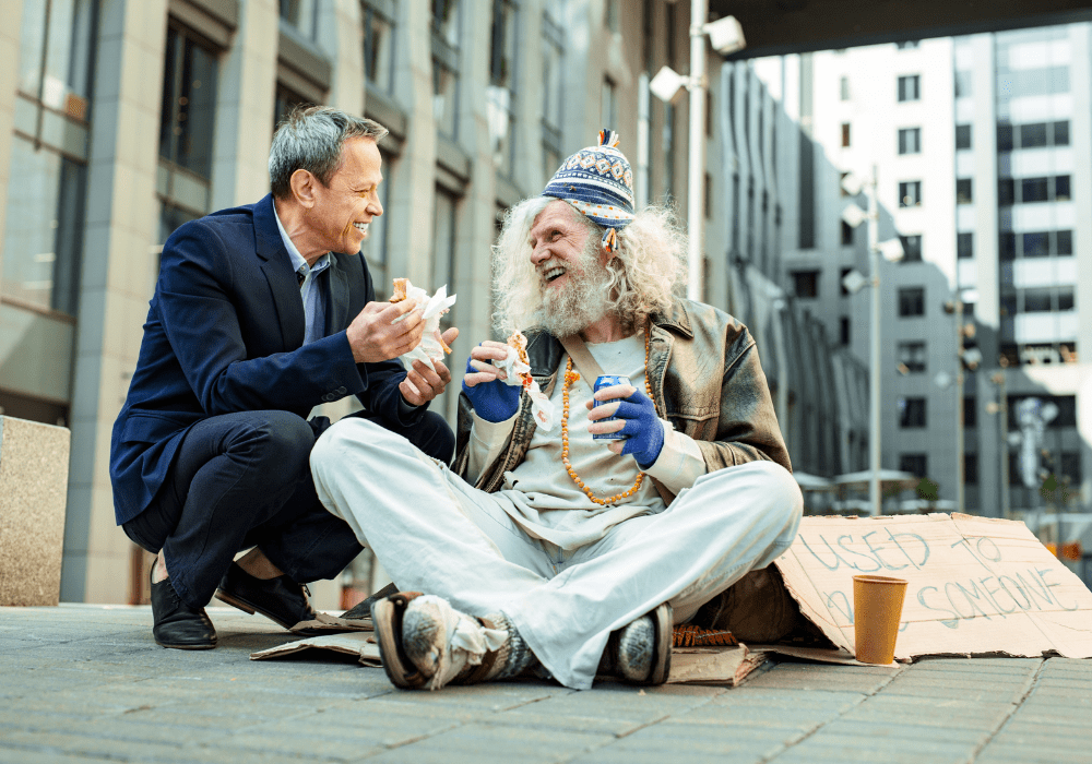 Man being kind to another man in the street.