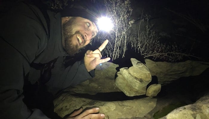 Chase Using His Headlamp To Stack Rocks While Backpacking Northern California