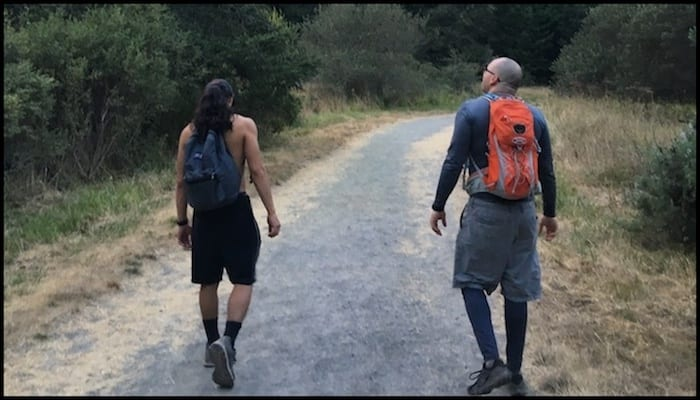 Hikers walking on a trail with Different Hiking Packs | AdventureHacks