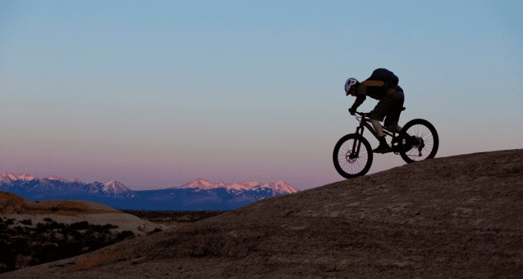 David Aston and His Friend Ricky Burton mountain bike from Durango to Moab during a beautiful sunset