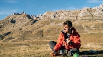 Backpacking Meal Planning 101 - Man eating lunch during his backpacking trip