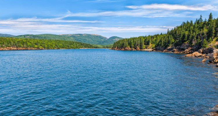 AdventureHacks team take a breather during their hike in Acadia National Park. Picture is of one of the many gorgeous lakes in the area.