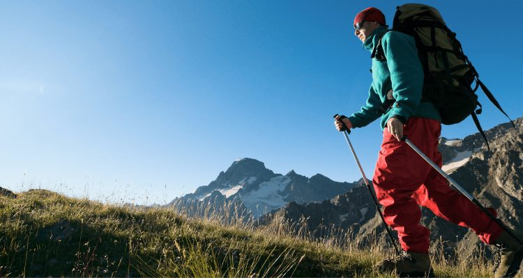 Man hiking on a mountain to lose weight and remain healthy