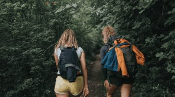 two women with gear on a day hike