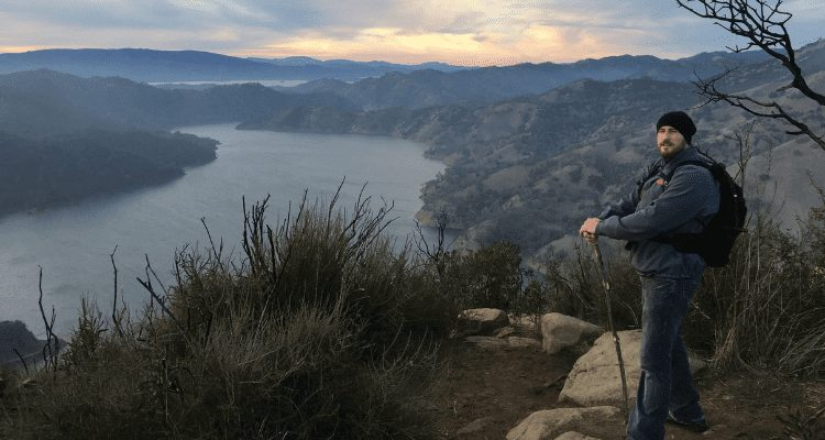 Chase with a manzanita hiking stick during a northern california day hike