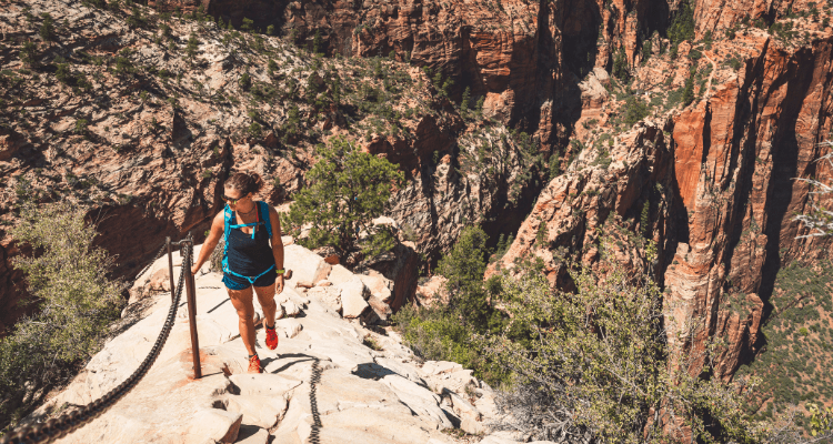 Woman performing a difficult hike with minimal effort due to her training